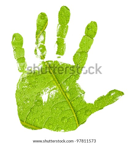 conceptual hand imprint on green leaf background