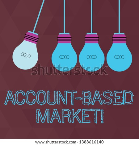 Conceptual hand writing showing Account Based Market. Business photo text resources target a key group of specific accounts Color Pendant Bulb Hanging with One Different Shade Lightbulb.