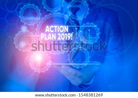Conceptual hand writing showing Action Plan 2019. Business photo showcasing proposed strategy or course of actions for current year Picture photo network scheme with modern smart device. #1548381269