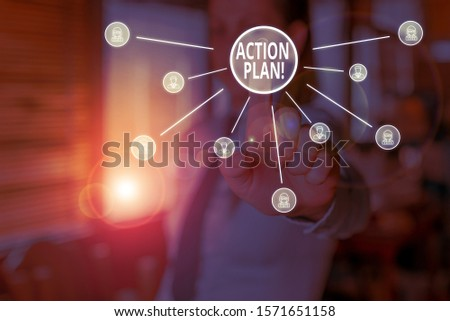 Conceptual hand writing showing Action Plan. Business photo showcasing proposed strategy or course of actions for certain time Woman wear suit presenting presentation using smart device. #1571651158