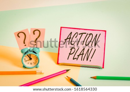Conceptual hand writing showing Action Plan. Business photo showcasing proposed strategy or course of actions for certain time Mini size alarm clock beside stationary on pastel backdrop.
