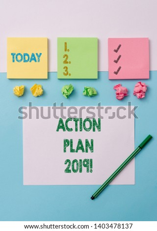 Conceptual hand writing showing Action Plan 2019. Business photo text proposed strategy or course of actions for current year Stationary placed sideways on top of the softhued backdrop. #1403478137
