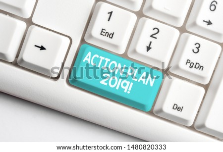 Conceptual hand writing showing Action Plan 2019. Business photo text proposed strategy or course of actions for current year White pc keyboard with note paper above the white background. #1480820333