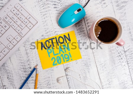 Conceptual hand writing showing Action Plan 2019. Business photo text proposed strategy or course of actions for current year Technological devices colored reminder paper office supplies.