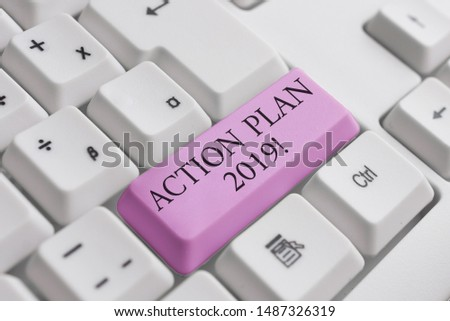 Conceptual hand writing showing Action Plan 2019. Business photo text proposed strategy or course of actions for current year White pc keyboard with note paper above the white background.