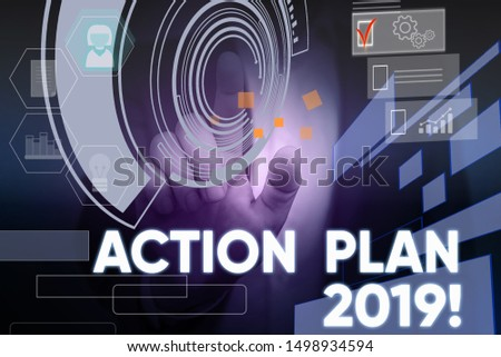 Conceptual hand writing showing Action Plan 2019. Business photo text proposed strategy or course of actions for current year Male wear formal suit presenting presentation smart device.