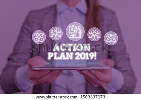 Conceptual hand writing showing Action Plan 2019. Business photo text proposed strategy or course of actions for current year Woman wear work suit presenting presentation smart device.