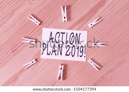 Conceptual hand writing showing Action Plan 2019. Business photo text proposed strategy or course of actions for current year Colored crumpled papers wooden floor background clothespin.