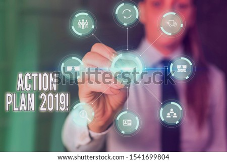 Conceptual hand writing showing Action Plan 2019. Business photo text proposed strategy or course of actions for current year Picture photo network scheme with modern smart device. #1541699804