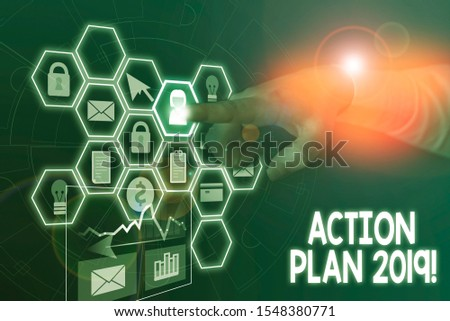 Conceptual hand writing showing Action Plan 2019. Business photo text proposed strategy or course of actions for current year Picture photo network scheme with modern smart device. #1548380771