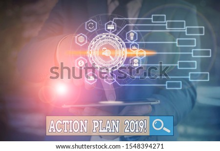 Conceptual hand writing showing Action Plan 2019. Business photo text proposed strategy or course of actions for current year Picture photo network scheme with modern smart device. #1548394271