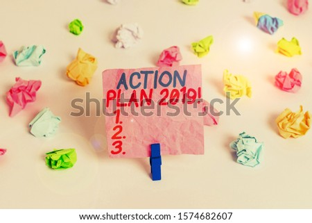 Conceptual hand writing showing Action Plan 2019. Business photo text proposed strategy or course of actions for current year Colored crumpled paper empty reminder white floor clothespin. #1574682607