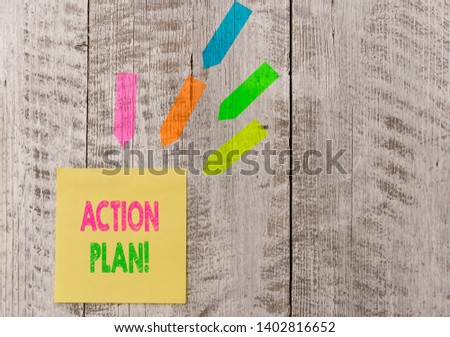 Conceptual hand writing showing Action Plan. Business photo text proposed strategy or course of actions for certain time Note paper and line arrow stickers on the top of wooden table desk. #1402816652