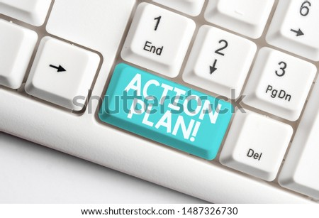 Conceptual hand writing showing Action Plan. Business photo text proposed strategy or course of actions for certain time White pc keyboard with note paper above the white background.