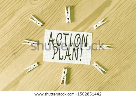 Conceptual hand writing showing Action Plan. Business photo text proposed strategy or course of actions for certain time Colored crumpled papers wooden floor background clothespin.