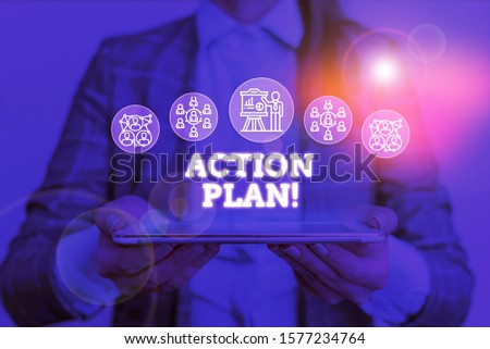 Conceptual hand writing showing Action Plan. Business photo text proposed strategy or course of actions for certain time Woman wear work suit presenting presentation smart device. #1577234764