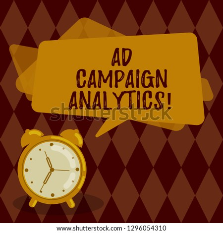 Conceptual hand writing showing Ad Campaign Analytics. Business photo showcasing monitor campaigns and their respective outcomes Rectangular Speech Bubble Overlay and Analog Alarm Clock.