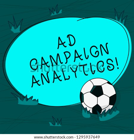 Conceptual hand writing showing Ad Campaign Analytics. Business photo text monitor campaigns and their respective outcomes Soccer Ball on the Grass and Blank Round Color Shape photo.