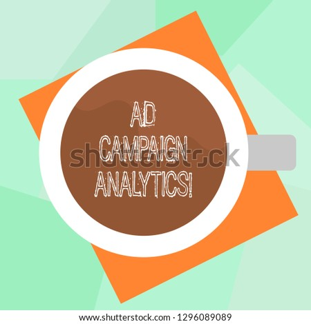 Conceptual hand writing showing Ad Campaign Analytics. Business photo text monitor campaigns and their respective outcomes Top View of Drinking Cup Filled with Beverage on Color Paper.