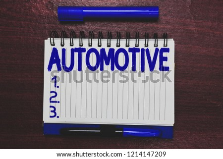 Conceptual hand writing showing Automotive. Business photo text Selfpropelled Related to motor vehicles engine cars automobiles Open notebook page marker communicating ideas wooden background. #1214147209