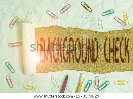Conceptual hand writing showing Background Check. Business photo text investigation into a demonstrating s is origins and previous history Stationary and torn cardboard on a wooden classic table #1573590829