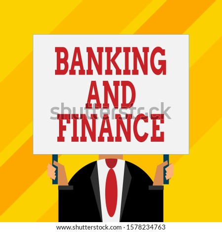 Conceptual hand writing showing Banking And Finance. Business photo showcasing Accounting and entities stocks Money interests Just man chest dressed dark suit tie holding big rectangle.