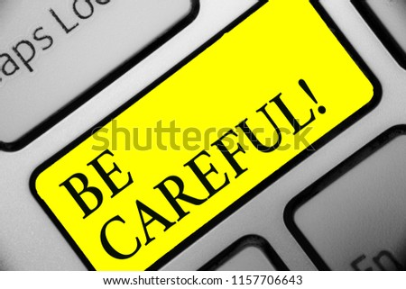 Conceptual hand writing showing Be Careful. Business photo showcasing making sure of avoiding potential danger mishap or harm Keyboard yellow key computer computing reflection document. #1157706643