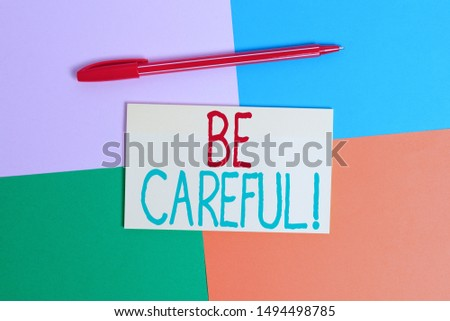 Conceptual hand writing showing Be Careful. Business photo text making sure of avoiding potential danger mishap or harm Office appliance square desk study supplies paper sticker. #1494498785