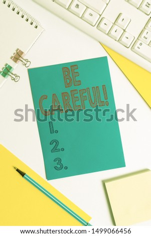 Conceptual hand writing showing Be Careful. Business photo text making sure of avoiding potential danger mishap or harm Colored paper binder clip sheets white desk empty space. #1499066456