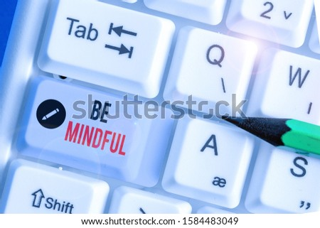 Conceptual hand writing showing Be Mindful. Business photo showcasing paying close attention to or being conscious of something.