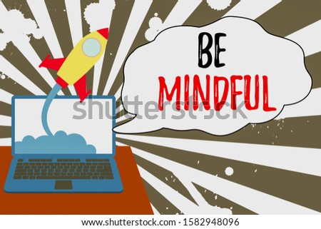 Conceptual hand writing showing Be Mindful. Successful rocket launching laptop background Startup grow.
