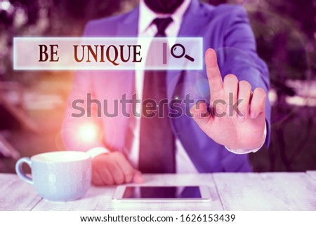 Conceptual hand writing showing Be Unique. Business photo text being the only one of its kind Unlike anything else Incomparable Businessman with pointing finger in front of him.