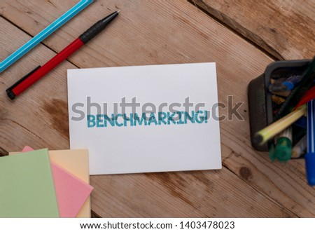Conceptual hand writing showing Benchmarking. Business photo showcasing evaluate something by comparison with standard or scores Note papers and stationary placed sideways softhued backdrop. #1403478023