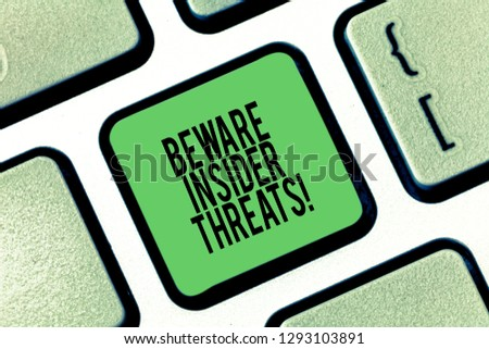 Conceptual hand writing showing Beware Insider Threats. Business photo showcasing Be cautious on malicious attack inside the network Keyboard key Intention to create computer message idea. #1293103891