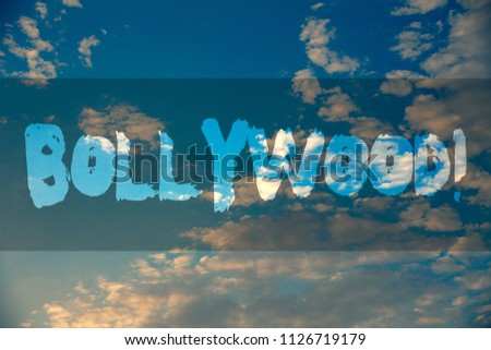 Conceptual hand writing showing Bollywood Motivational Call. Business photo showcasing Hollywood Movie Film Entertainment Cinema Ideas message reflection cloudy sky sunset natural landscape. #1126719179