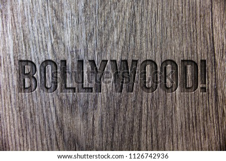 Conceptual hand writing showing Bollywood Motivational Call. Business photo showcasing Hollywood Movie Film Entertainment Cinema Wooden background vintage wood board message ideas feelings. #1126742936