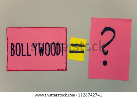 Conceptual hand writing showing Bollywood Motivational Call. Business photo text Hollywood Movie Film Entertainment Cinema Paper equal sign question marks beige background doubt message. #1126742741