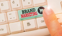 Conceptual hand writing showing Brand Marketing. Business photo text creating a name that identifies and differentiates a product.
