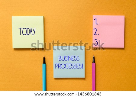 Conceptual hand writing showing Business Processes. Business photo showcasing Methods practices involves in running a commerce Front view colored sticky note ballpoints yolk background.