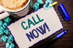 Conceptual hand writing showing Call Now. Business photo showcasing Contact Talk Chat Hotline Support Telephony Customer Service written Cardboard Piece on wooden background Today Pen Coffee.
