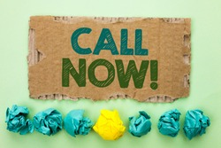Conceptual hand writing showing Call Now. Business photo text Contact Talk Chat Hotline Support Telephony Customer Service written on Tear Cardboard on plain background Crumpled Paper Balls.