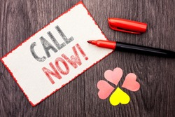 Conceptual hand writing showing Call Now. Business photo text Contact Talk Chat Hotline Support Telephony Customer Service written on Cardboard Piece With Marker on wooden background Hearts.