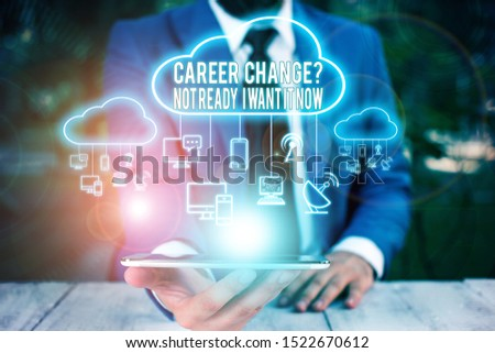 Conceptual hand writing showing Career Change Question Not Ready I Want It Now. Business photo text Seeking new opportunities job Male wear formal work suit presenting presentation smart device.