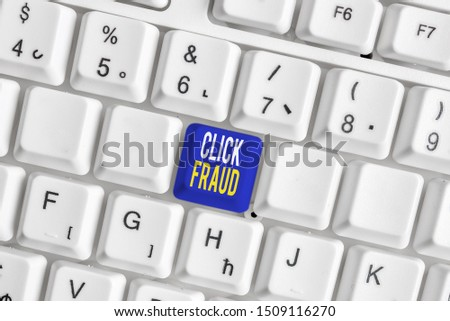 Conceptual hand writing showing Click Fraud. Business photo text practice of repeatedly clicking on advertisement hosted website White pc keyboard with note paper above the white background. #1509116270