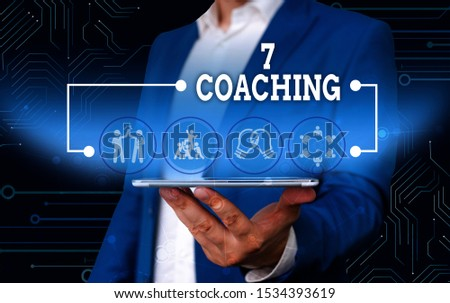 Conceptual hand writing showing 7 Coaching. Business photo text Refers to a number of figures regarding business to be succesful Male wear formal work suit presenting presentation smart device.