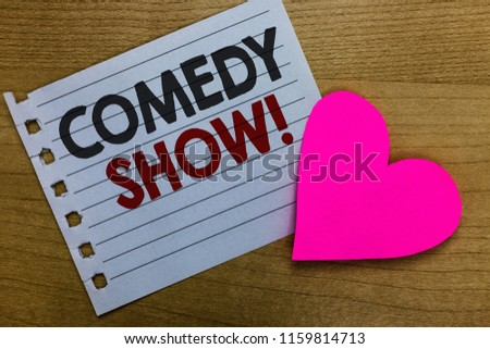 Conceptual hand writing showing Comedy Show. Business photo showcasing Funny program Humorous Amusing medium of Entertainment Notebook paper Romantic ideas heart feelings Wooden table.