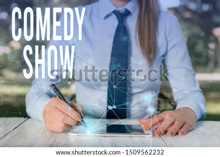 Conceptual hand writing showing Comedy Show. Business photo showcasing Funny program Humorous Amusing medium of Entertainment Female human wear formal work suit presenting smart device. #1509562232