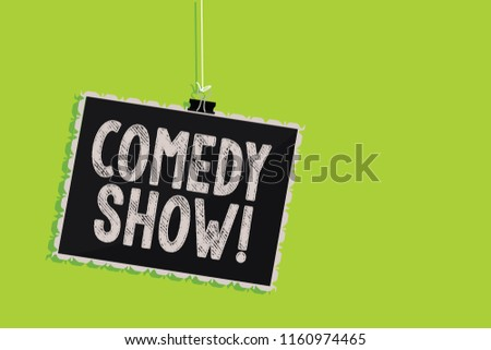 Conceptual hand writing showing Comedy Show. Business photo text Funny program Humorous Amusing medium of Entertainment Hanging blackboard message communication sign green background.