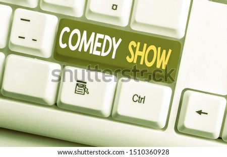 Conceptual hand writing showing Comedy Show. Business photo text Funny program Humorous Amusing medium of Entertainment White pc keyboard with note paper above the white background. #1510360928