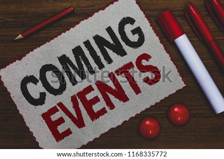 Conceptual hand writing showing Coming Events. Business photo showcasing Happening soon Forthcoming Planned meet Upcoming In the Future White paper red borders markers pencils wooden background.